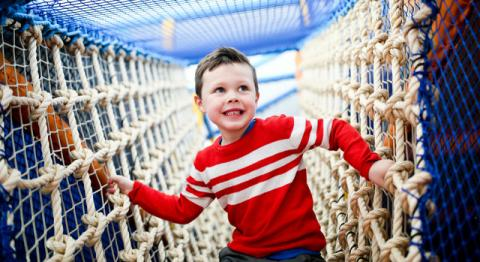 Boy on the Soft Play ropes at Ards Blair Mayne
