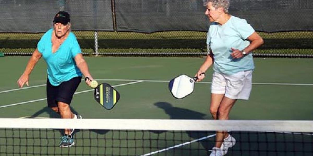 two ladies playing pickleball